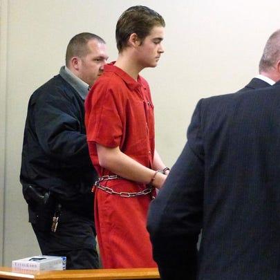FILE: William Brandon Aydelott, 17, is led into a Santa