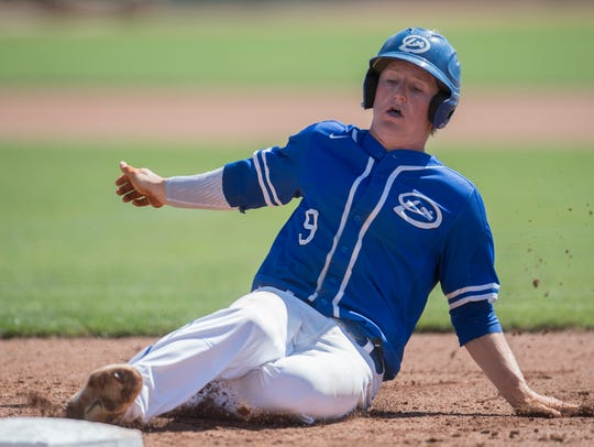 Dixie High School's Hobbs Nyberg slides back to first