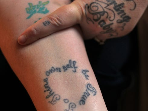 Betina Pierson, shows a tattoo that her daughter Tierra helped her design, Wednesday, Dec. 4, 2013.