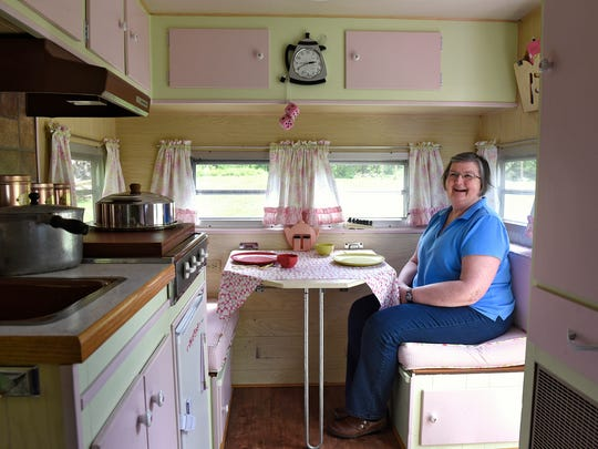 Sue Notch sits at the table in her camper Celia Rose Tuesday, May 17, at her home near Avon. Just about every decoration or item in the trailer has some personal meaning to her.