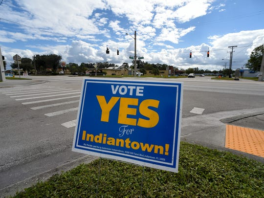 Signs posted along Southwest Warfield Boulevard encourage Indiantown residents to vote for or against Indiantown to become an unincorporated village from Martin County. The referendum was put on the ballot Nov. 7 and by a 63 percent margin, residents approved incorporation.