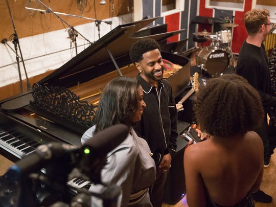 Big Sean speaks to special guests at Studio A in the Motown Museum in Detroit on Thursday, June 21, 2018. To the left of the rapper is museum chairwoman Robin Terry.