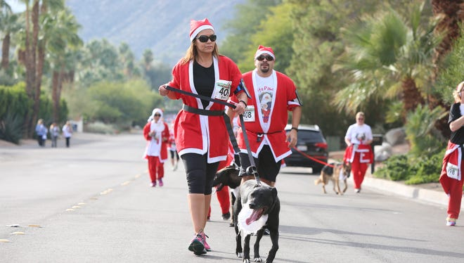 Sylvia and Gabriel Rios of Coachella participate in the Santa Paws 5K run/walk in Palm Springs on December 20, 2014. The event benefits the Guide Dogs of the Desert.