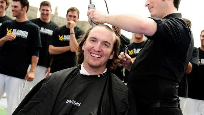 Former baseball player Scott Klever was among those who shaved his head in 2014 as part of Xavier's fundraiser for childhood cancer research. Thirty-one players will do so at noon Sunday for this year's campaign.