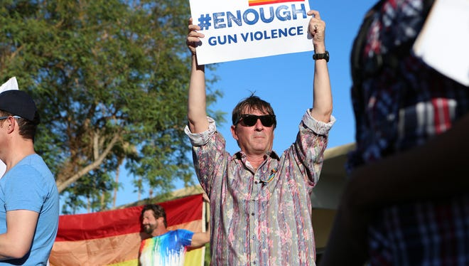 Richard Noble of Palm Springs holds a sign during a vigil held on Arenas Road for the victims of the mass shooting in Orlando that left 50 people dead in Palm Springs Sunday evening, June 12, 2016. Noble helped to draft the resolution passed Wednesday by the Palm Springs City Council urging Congress to pass the Equality Act.