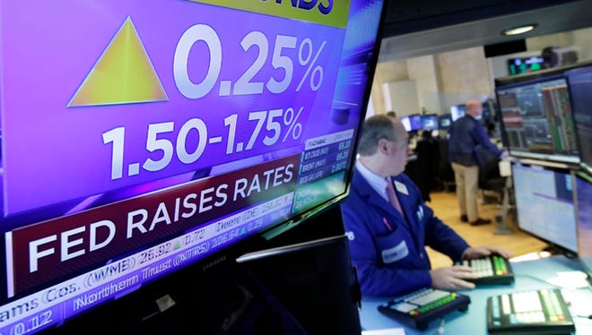 The Federal Reserve is expected to raise rates on Wednesday. The last time the Fed boosted rates was in March 2018. In this file photo, specialist Edward Loggie works on the floor of the New York Stock Exchange as the rate decision of the Federal Reserve was announced in March.
