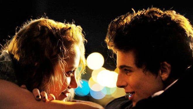 "Maika Monroe, left, and Timothée Chalamet in ""Hot Summer Nights."""