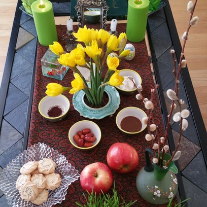 A Nowruz table is set with seven items – traditionally,