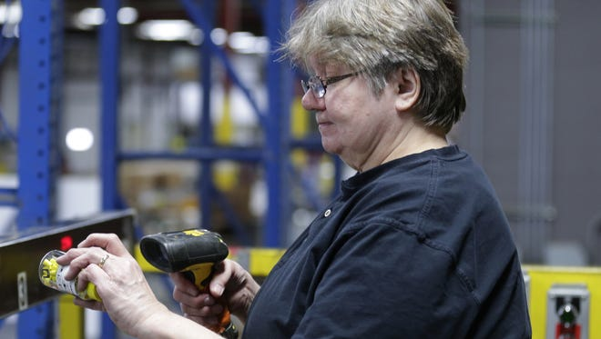 Diane Planert works in the warehouse at Werner Electric Supply  in Neenah.