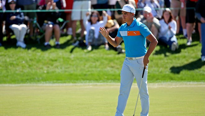 Rickie Fowler reacts after making a birdie putt on the 6th hole during the second round of the Honda Classic at PGA National.