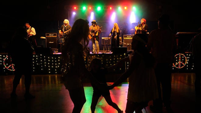 Fans dance as Soul Free Revival performs during Garage Band Woodstock 6 in 2015, at the Taylor County Expo Center. The event returns July 15.