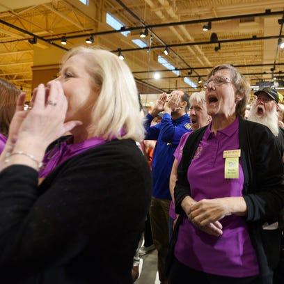 Wegmans employees share a final cheer before opening