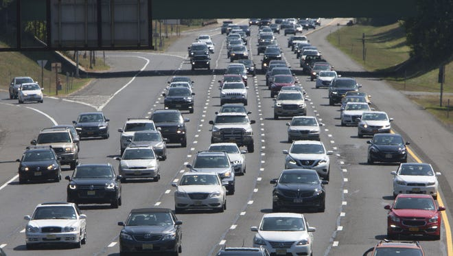 Heavy traffic like this, seen on the Garden State Parkway headed north in Tinton Falls, contributes to unhappiness in New Jersey.