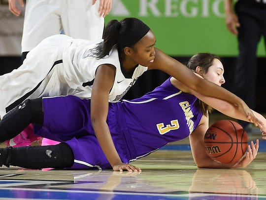 Destinee Wells (24) and Ellie Treanton (3) battle for a loose ball as Houston County plays Clarksville in Division I, Class AAA girls basketball state quarterfinals