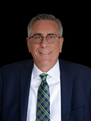 Gene Hunt, 61, a court-appointed attorney for Dearborn's 19th district court, is running for district judge