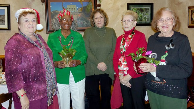 (From left) Norene Ritter, president, Woman's Club of Vineland, Annie Mae Jeffers, new member, Linda Foster, member, Joyce Prochaska, member, and Jane Pearce, new member, attended the club's Christmas luncheon at The Maplewood.