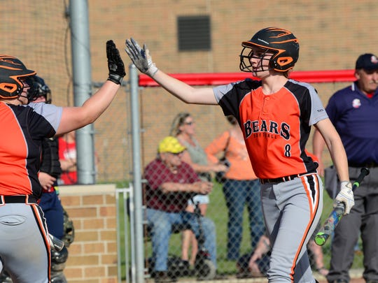 Gibsonburg's Keely Snyder scores one of her three runs Tuesday.