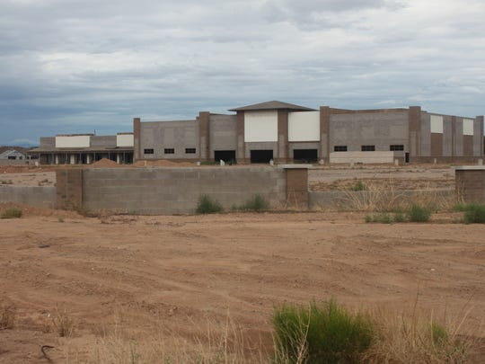 """The partially-constructed """"Shoppes at Chandler Heights,"""" on the northeastern corner of Chandler Heights Road and Arizona Avenue, has stood empty for years. The property went to new ownership this year and the broker is currently in talks with a national charter school interested in buying the 16.5-acre property."""