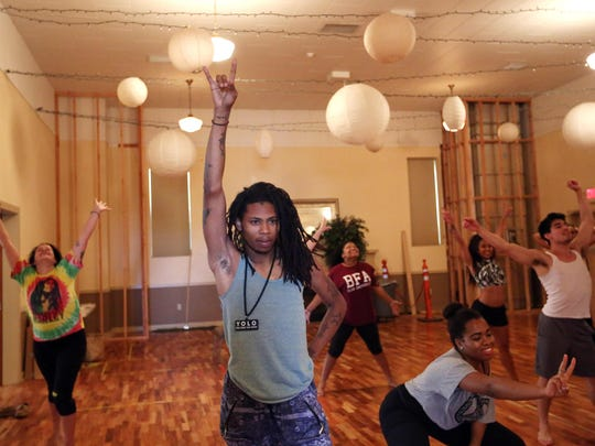 """Tribe members rehearse scenes for the current production of Enlightened Theatrics' """"Hair: The American Tribal Love-Rock Musical."""" Performances run through Aug. 16 at the Grand Theatre."""