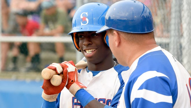Staunton Braves, Jordan Howard talks with his head coach, George Laase, before batting in the first inning on June 19.