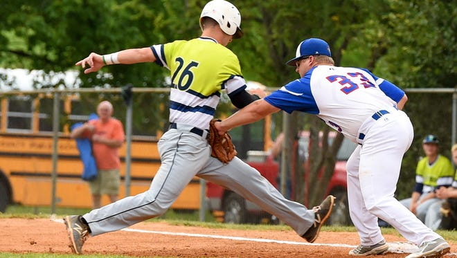 Staunton Braves' first baseman Austin Edens tags out Charlottesville TomSox's Seth Lancaster before he can jump back to first base on a successful pickoff attempt in the first inning. Staunton Braves faced off against the Charlottesville TomSox during a Valley Baseball League game played in Staunton on Friday, June 19, 2015.