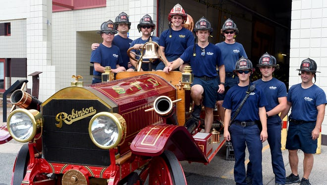 Inspired by an old photo, fire fighters with the Staunton Fire Department decided to have a group photo made of them with the department's oldest fire truck, the oldest motorized fire engine in Virginia actually, on Wednesday, July 13, 2016. Staunton first purchased the fire engine back in 1912. Normally the 1911 Robinson fire engine spends its retirement on display within the museum inside the firehouse. However, Jumbo found itself outside for photos while work took place inside the museum.