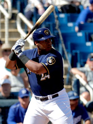 Jesus Aguilar takes an at bat in spring training.