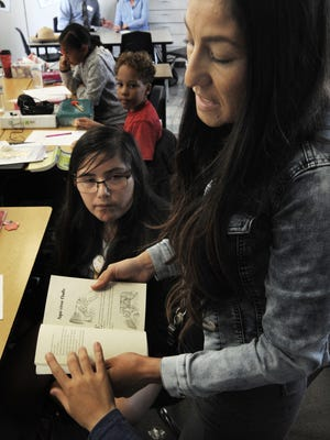 Edelmira Shuman teaches a fifth-grade dual-immersion class as she stands next to Katherina Vasquez at Bard School in Port Hueneme. Two seats were open on the Hueneme school board, and voters picked Vianey Lopez and Darlene Bruno.
