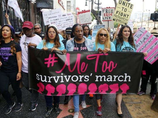 Civil rights activist Tarana Burke (center), who started the #MeToo movement, marches with survivors of sexual misconduct and their supporters in November in Los Angeles.