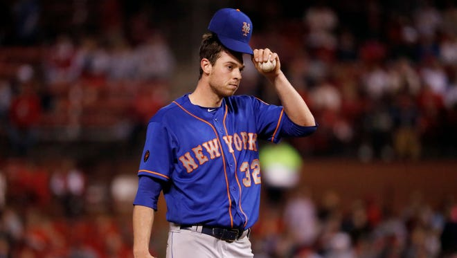 New York Mets starting pitcher Steven Matz waits on the mound before being removed during the fourth inning of the team's baseball game against the St. Louis Cardinals on Wednesday, April 25, 2018, in St. Louis.