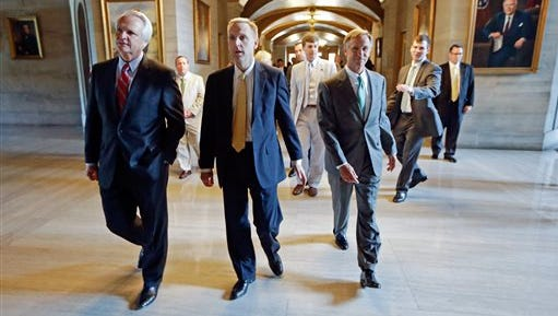 FILE - In this April 17, 2014, file photo, Republican Gov. Bill Haslam, right, Chief of Staff Mark Cate, center, and Senate Speaker Ron Ramsey walk to a news conference at the state Capitol in Nashville, Tenn. The Haslam administration announced Wednesday, May 13, 2015, that Cate is leaving his position as the governor's point man this summer. (AP Photo/Mark Humphrey, file)