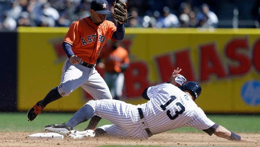 New York Yankees' Alex Rodriguez (13) steals second base under Houston Astros second baseman Jose Altuve during the third inning of the baseball game at Yankee Stadium, Tuesday, April 5, 2016 in New York.