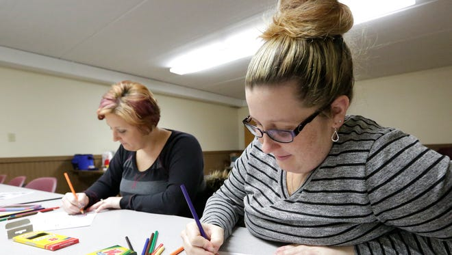 Sisters Melinda Serwe and Jennifer Parks of Brownsville take part in an adult coloring program at the Brownsville Public Library in Dodge County.