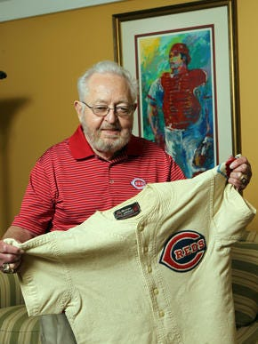 Bernie Stowe, longtime Cincinnati Reds equipment manager, with the uniform shirt he wore as a bat boy at the 1953 All-Star Game at Crosley Field. Behind him on the wall is a print of Johnny Bench by Leroy Neiman