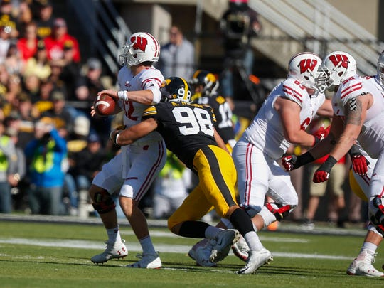 Iowa defensive end Anthony Nelson puts pressure on Wisconsin quarterback Alex Hornibrook on Saturday, Oct. 22, 2016, at Kinnick Stadium in Iowa City.
