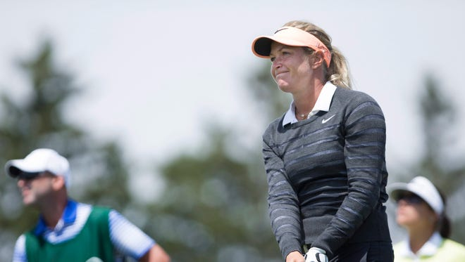 Suzann Pettersen, of Norway, watches her shot off the first tee to begin her final round of the 2015 Manulife LPGA Classic in Cambridge, Ontario, Sunday, June 7, 2015.