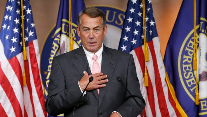 House Speaker John Boehner speaks during a news conference in which he said that he would resign from Congress at the end of October.