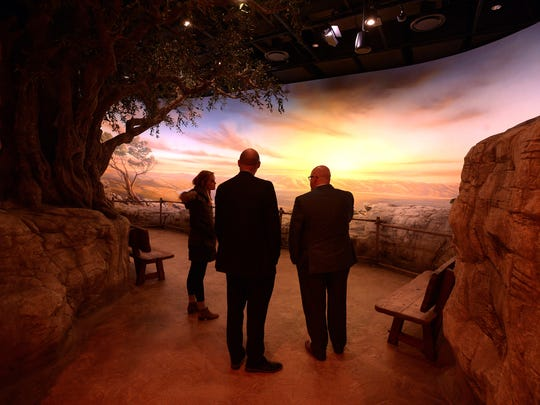 People stop to admire a diorama depicting the Sea of