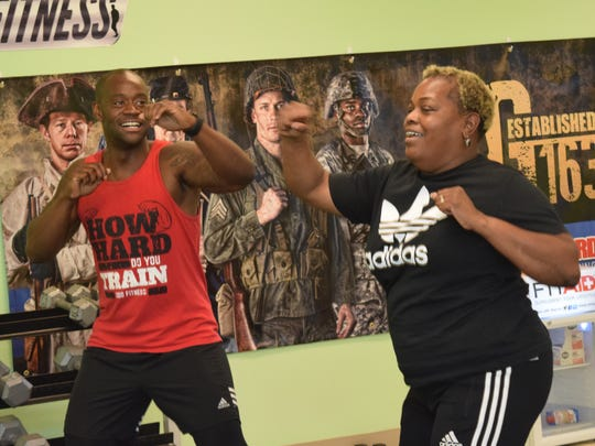 Steve Ranel (left), owner of 300 Fitness, leads a S.W.E.A.T. class through boxing drills. Sheena Jefferson was attending for the first time. The class is held at 6:30 p.m. on Tuesdays. The class is mainly for introducing people to fitness. There is no commitment to sign up for a certain number of classes. The drop-in rate is $10 per class.