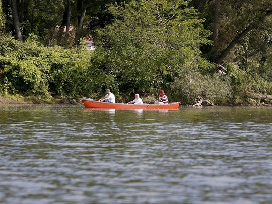 Three Fishermen paddle upstream on the Chemung River, Wednesday, Aug. 5. near the Grove St. Boat Launch.