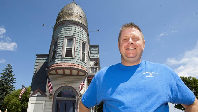 Dave Nennig stands in front of Harbor Lights Tavern. Nennig has remodeled the establishment to give a nod to the building's long history.