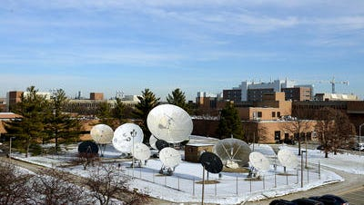 A view of the dish farm outside the Communication Arts and Sciences building on the campus of Michigan State University. WKAR's offices are located inside the building.