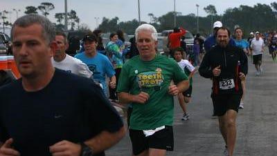Jerry Bird runs in a recent race wearing his Tooth Trot 5K shirt.