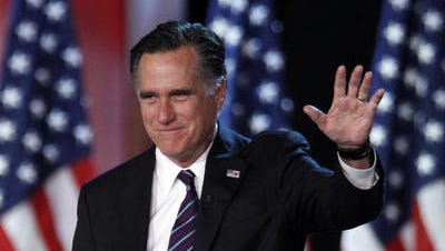 This Nov. 7, 2012 file photo shows Republican presidential candidate, former Massachusetts Gov. Mitt Romney waving to supporters at an election night rally in Boston.