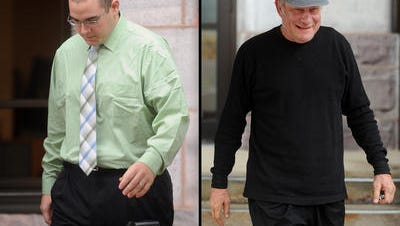 Adam Dupic and David Twedt each walk out of the Federal Courthouse in Sioux Falls Wednesday, Oct 12, 2011.