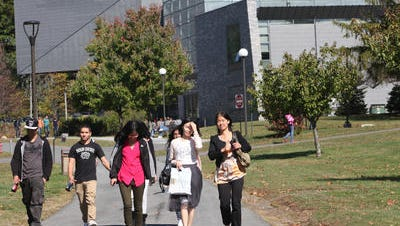 Students walk to class on the campus of Westchester Community College.
