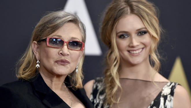 In this Nov. 14, 2015, file photo, Carrie Fisher, left, and her daughter Billie Catherine Lourd arrive at the Governors Awards at the Dolby Ballroom in Los Angeles.