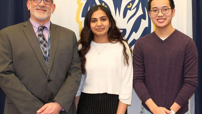 Two Highland High School (HHS) students—seniors Minh Tran and Ishani Bansal— were named finalists by the National Merit Scholarship Corporation (NMSC) for the National Merit Scholarship, a prestigious award given to the nation's top students. Tran and Bansal are joined by Highland High School Principal William Zimmer.