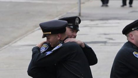 Mourners start arriving for the service for slain Officer Daryl Pierson at the War Memorial at the Blue Cross Arena.