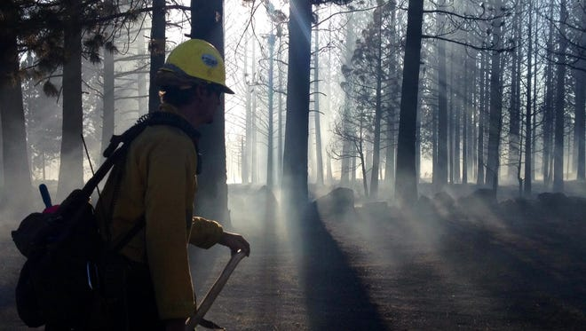 A firefighter at the scene of the Boca fire on Monday in Northern California.